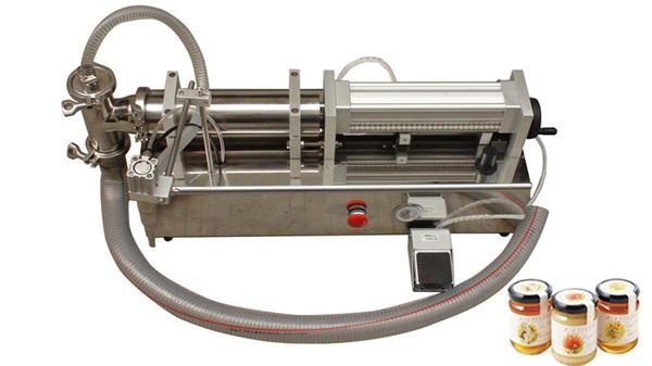 Macchina di riempimento di miele liquido di alta viscosità semiautomatica