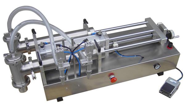 수동 액체 충전물 기계
